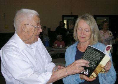 Vernon Nishi and Karen Sorenson chatting on Centennial Sunday