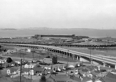 Taken from Albany Hill looking west, photo shows the Naval Landing Force Equipment Depot. With the onset of World War II, the United States Navy took over Golden Gate Fields race track, for the storage and repair of landing craft for use in the Pacific.